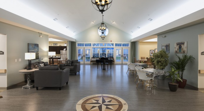 Open Room with Piano and Large Windows at Peregrine Senior Living at Colonie