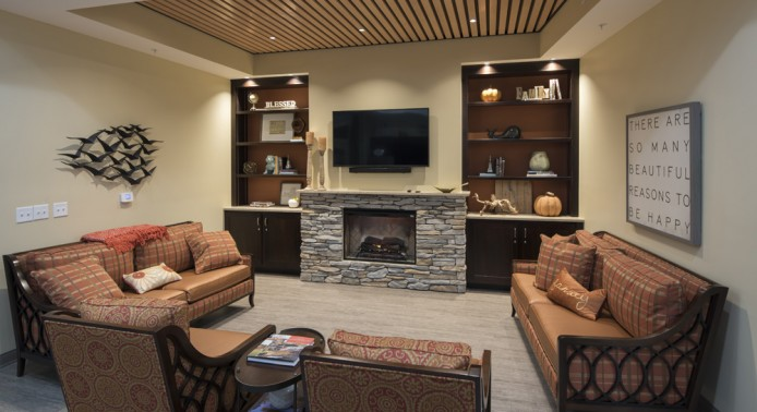 Living Room with Fireplace at Peregrine Senior Living at Colonie